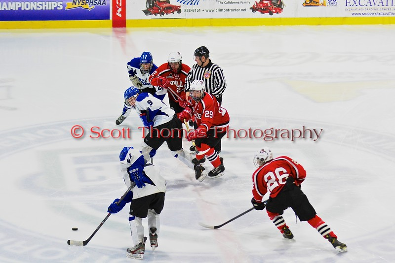 Baldwinsville Bees and Saratoga Springs Blue Streaks face off in NYSPHSAA Division I Boys Hockey Championships at the Utica Memorial Auditorium in Utica, New York on Saturday, March 14, 2015.  Baldwinsville won 2-1 in overtime.