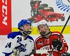 Baldwinsville Bees Kyle Lindsay (26) and Saratoga Springs Blue Streaks Jake Fauler (24) before the start of overtime in NYSPHSAA Division I Boys Hockey Championships at the Utica Memorial Auditorium in Utica, New York on Saturday, March 14, 2015.  Baldwinsville won 2-1 in overtime.