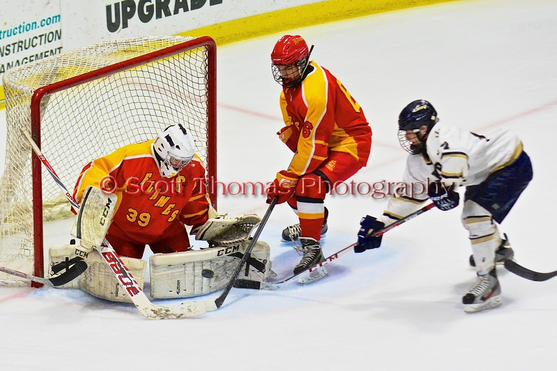 Williamsville East Flames goalie Max Battistoni (39) makes a pad save on Skaneateles Lakers Michael Soden (17) in NYSPHSAA Division II Boys Hockey Championships at the Utica Memorial Auditorium n Utica, New York on Sunday, March 15, 2015.  Skaneateles won 5-2.