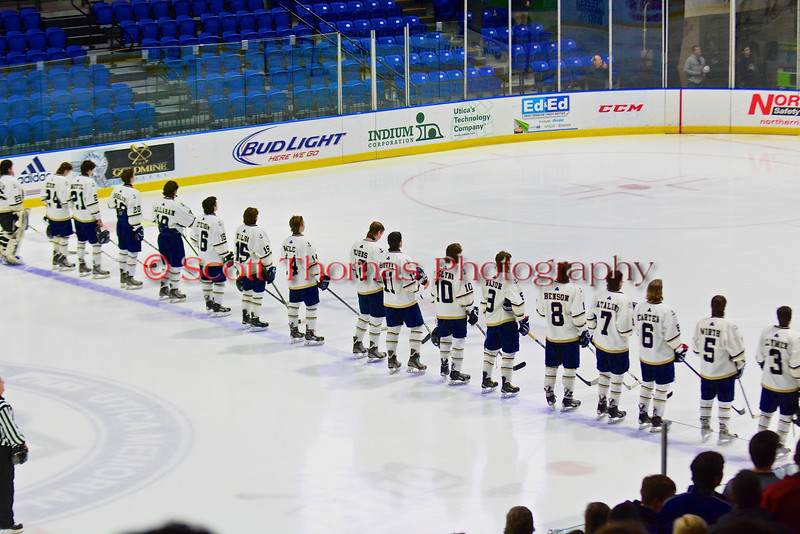 Skaneateles Lakers players during the National Anthem before playing the Williamsville East Flames in NYSPHSAA Division II Boys Hockey Championships at the Utica Memorial Auditorium n Utica, New York on Sunday, March 15, 2015.