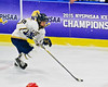 Skaneateles Lakers Raymond Falso (15) with the puck against the Williamsville East Flames in NYSPHSAA Division II Boys Hockey Championships at the Utica Memorial Auditorium n Utica, New York on Sunday, March 15, 2015.  Skaneateles won 5-2.