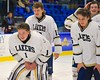 Skaneateles Lakers players goalie Bennett Morse (1), Cullen McGlynn (10) and Briggs Carter (6) after beating the Williamsville East Flames in NYSPHSAA Division II Boys Hockey Championships at the Utica Memorial Auditorium n Utica, New York on Sunday, March 15, 2015.  Skaneateles won 5-2.