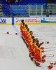 Williamsville East Flames players during the National Anthem before playing the Skaneateles Lakers in NYSPHSAA Division II Boys Hockey Championships at the Utica Memorial Auditorium n Utica, New York on Sunday, March 15, 2015.