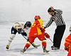 Skaneateles Lakers and Williamsville East Flames in the opening face-off in NYSPHSAA Division II Boys Hockey Championships at the Utica Memorial Auditorium n Utica, New York on Sunday, March 15, 2015.  Skaneateles won 5-2.