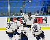 Skaneateles Lakers Raymond Falso (15) celebrates his goal against the Williamsville East Flames with this teammates in NYSPHSAA Division II Boys Hockey Championships at the Utica Memorial Auditorium n Utica, New York on Sunday, March 15, 2015.  Skaneateles won 5-2.