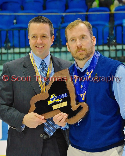 Skaneateles Lakers Head Coach Mitch Major with the  NYSPHSAA Division II Boys Hockey Championship trophy at the Utica Memorial Auditorium n Utica, New York on Sunday, March 15, 2015.  Skaneateles won 5-2.