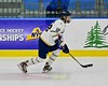 Skaneateles Lakers Owen Kuhns (12) looking to make a play against the Williamsville East Flames in NYSPHSAA Division II Boys Hockey Championships at the Utica Memorial Auditorium n Utica, New York on Sunday, March 15, 2015.  Skaneateles won 5-2.
