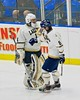 Skaneateles Lakers goalie Bennett Morse (1) fist taps Matt Benson (8) on his goal against the Williamsville East Flames in NYSPHSAA Division II Boys Hockey Championships at the Utica Memorial Auditorium n Utica, New York on Sunday, March 15, 2015.  Skaneateles won 5-2.
