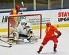 Skaneateles Lakers goalie Bennett Morse (1) gets a piece of a shot by Williamsville East Flames Alex Finley (17) in NYSPHSAA Division II Boys Hockey Championships at the Utica Memorial Auditorium n Utica, New York on Sunday, March 15, 2015.  Skaneateles won 5-2.