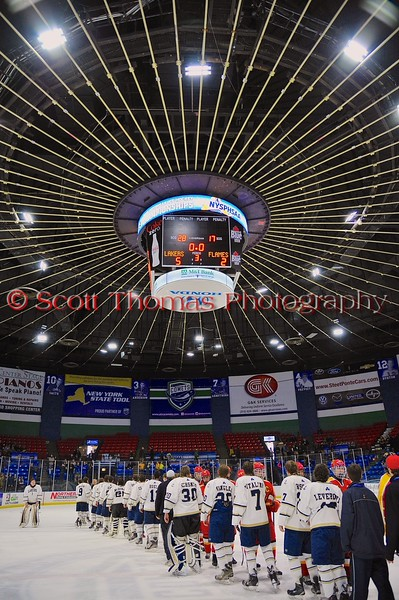Skaneateles Lakers and Williamsville East Flames shake hands after the NYSPHSAA Division II Boys Hockey Championship game at the Utica Memorial Auditorium n Utica, New York on Sunday, March 15, 2015.  Skaneateles won 5-2.