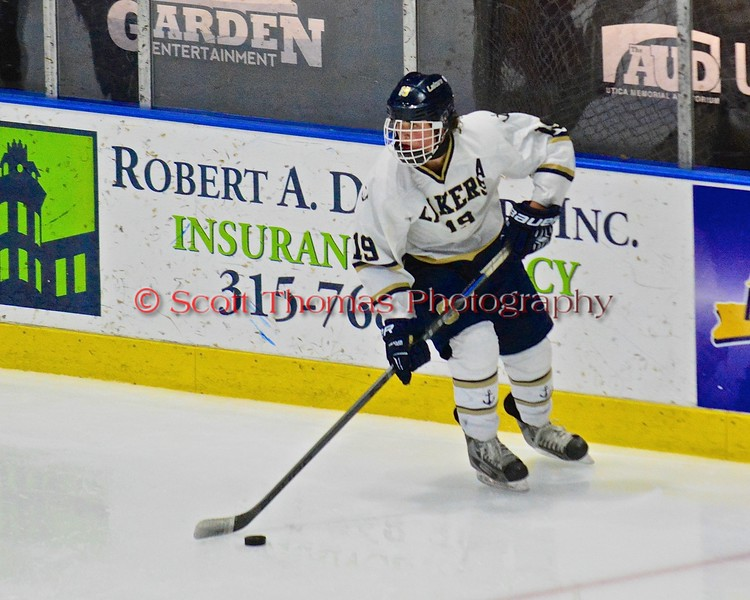 Skaneateles Lakers Devin Callahan (19) looking to make a play against the Williamsville East Flames in NYSPHSAA Division II Boys Hockey Championships at the Utica Memorial Auditorium n Utica, New York on Sunday, March 15, 2015.  Skaneateles won 5-2.