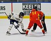 Skaneateles Lakers Cullen McGlynn (10) faces off with Williamsville East Flames Nick Piekarski (11) in NYSPHSAA Division II Boys Hockey Championships at the Utica Memorial Auditorium n Utica, New York on Sunday, March 15, 2015.  Skaneateles won 5-2.
