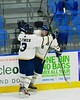 Skaneateles Lakers Sam Clymer (3) congratulates Matt Benson (8) on his goal against the Williamsville East Flames in NYSPHSAA Division II Boys Hockey Championships at the Utica Memorial Auditorium n Utica, New York on Sunday, March 15, 2015.  Skaneateles won 5-2.