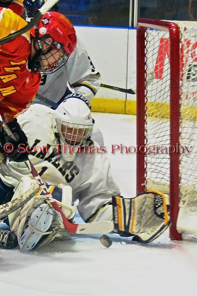 Skaneateles Lakers goalie Bennett Morse (1) keeps the puck out of the net against the Williamsville East Flames in NYSPHSAA Division II Boys Hockey Championships at the Utica Memorial Auditorium n Utica, New York on Sunday, March 15, 2015.  Skaneateles won 5-2.
