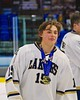 Skaneateles Lakers Raymond Falso (15) with his NYSPHSAA Division II Boys Hockey Championship medal at the Utica Memorial Auditorium n Utica, New York on Sunday, March 15, 2015.  Skaneateles won 5-2.