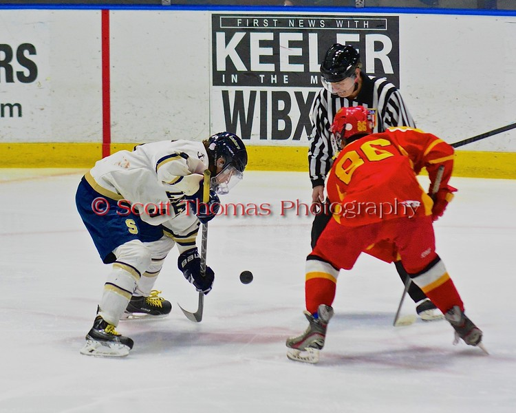 Skaneateles Lakers Patrick Major (9) faces off with Williamsville East Flames Matt Steffan (86) in NYSPHSAA Division II Boys Hockey Championships at the Utica Memorial Auditorium n Utica, New York on Sunday, March 15, 2015.  Skaneateles won 5-2.