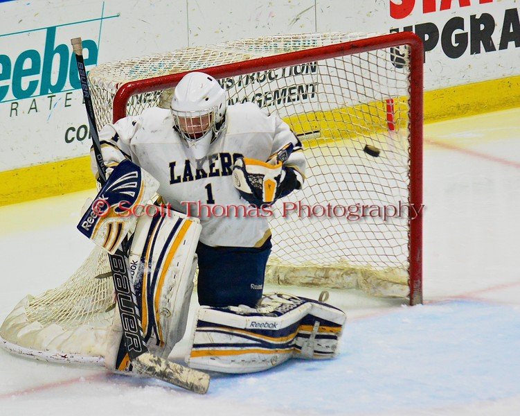 Skaneateles Lakers goalie Bennett Morse (1) makes a seven a shot by a Christian Brothers Academy/Jamesville-DeWitt player in NYSPHSAA Division II Boys Hockey Championships at the Utica Memorial Auditorium in Utica, New York on Saturday, March 14, 2015.  Skaneateles won 4-3.