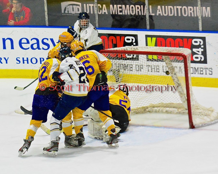 Skaneateles Lakers James Motyl (21) scores past a swarm of Christian Brothers Academy/Jamesville-DeWitt players in NYSPHSAA Division II Boys Hockey Championships at the Utica Memorial Auditorium in Utica, New York on Saturday, March 14, 2015.  Skaneateles won 4-3.