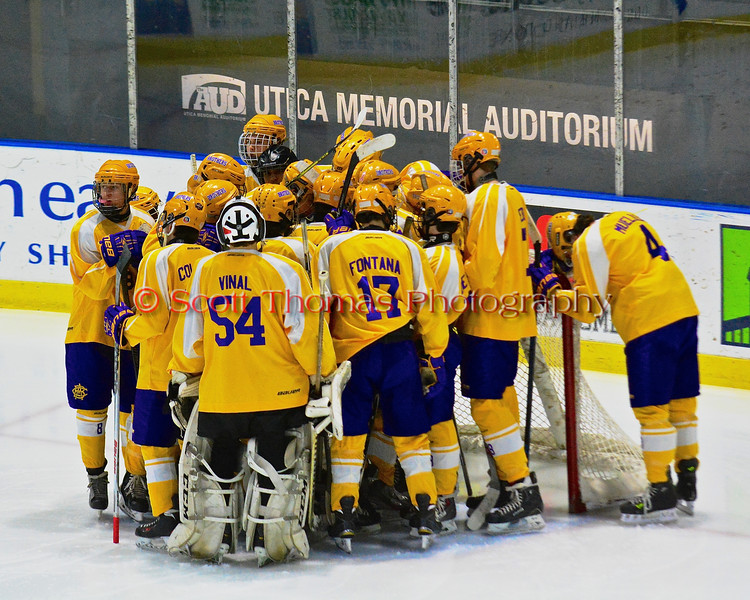 CBA-JD Brothers huddle up before playing the Skaneateles Lakers in NYSPHSAA Division II Boys Hockey Championships at the Utica Memorial Auditorium in Utica, New York on Saturday, March 14, 2015.