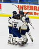 Skaneateles Lakers players celebrate Reece Eddy's (24) goal against the Christian Brothers Academy/Jamesville-DeWitt in NYSPHSAA Division II Boys Hockey Championships at the Utica Memorial Auditorium in Utica, New York on Saturday, March 14, 2015.  Skaneateles won 4-3.