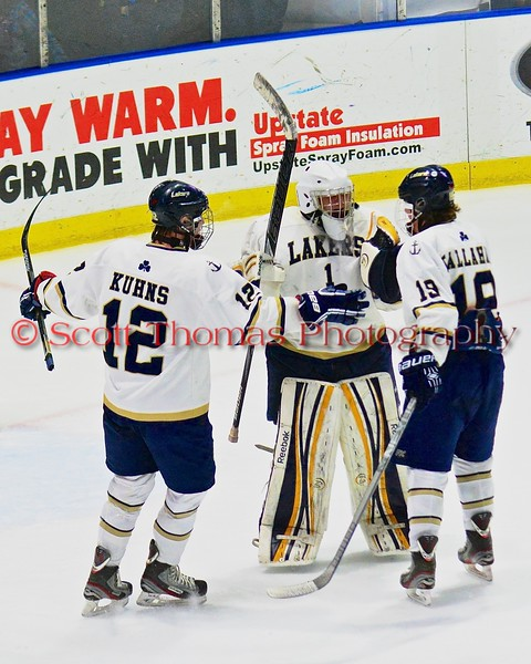 Skaneateles Lakers goalie Bennett Morse (1), Owen Kuhns (12) and Devin Callahan (19) celebrate their win over the Christian Brothers Academy/Jamesville-DeWitt in NYSPHSAA Division II Boys Hockey Championships at the Utica Memorial Auditorium in Utica, New York on Saturday, March 14, 2015.  Skaneateles won 4-3.