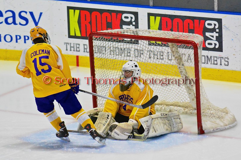 CBA-JD Brothers Tanner Coleman (15) gives a stick tap to goalie Gabe Vinal (54) before playing the Skaneateles Lakers in NYSPHSAA Division II Boys Hockey Championships at the Utica Memorial Auditorium in Utica, New York on Saturday, March 14, 2015.  Skaneateles won 4-3.