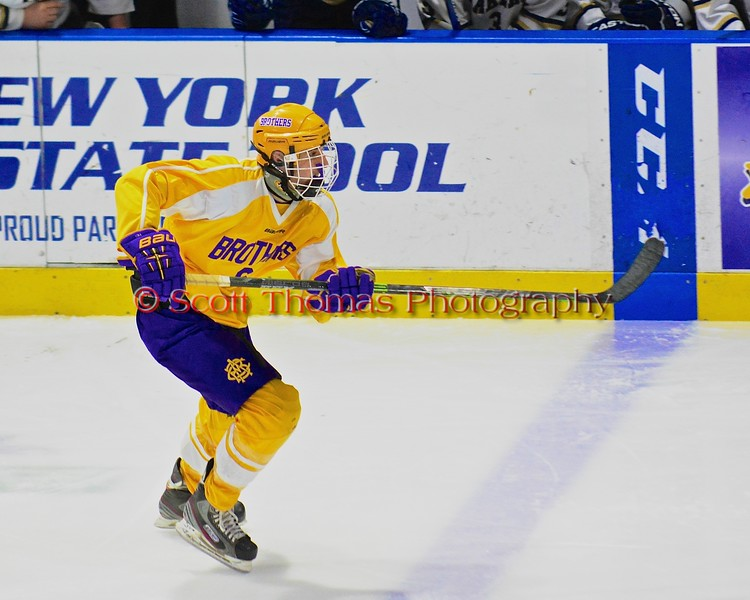 CBA-JD Brothers Kyle Barker (6) skating against the Christian Brothers Academy/Jamesville-DeWitt played the Skaneateles Lakers in NYSPHSAA Division II Boys Hockey Championships at the Utica Memorial Auditorium in Utica, New York on Saturday, March 14, 2015.  Skaneateles won 4-3.