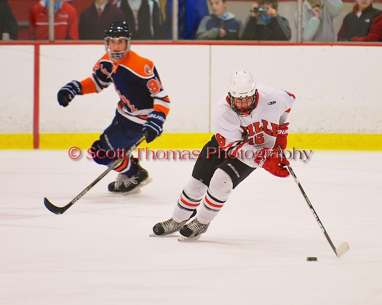 Baldwinsville Bees Carson Hayes (16) with the puck against the Liverpool Warriors at the Greater Baldwinsville Ice Arena in Baldwinsville, New York on Tuesday December 2, 2014.  Baldwinsville won 4-0.