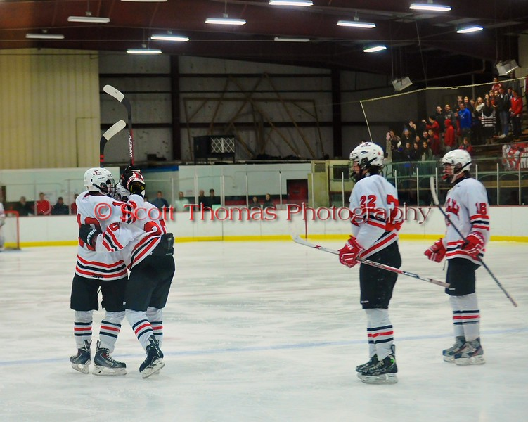 Baldwinsville Bees celebrate Joe Glamos' (18) goal against the the Liverpool Warriors at the Greater Baldwinsville Ice Arena in Baldwinsville, New York on Tuesday December 2, 2014.  Baldwinsville won 4-0.