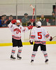 Baldwinsville Bees James Pelcher (17) celebrates his goal against the Liverpool Warriors with teammate Isaiah Pompo (5) at the Greater Baldwinsville Ice Arena in Baldwinsville, New York on Tuesday December 2, 2014.  Baldwinsville won 4-0.