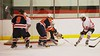 Liverpool Warriors goalie Steven Kozikoski (1) and Riley Thompson (13) work to clear a rebound from Baldwinsville Bees Adam Tretowicz (21) at the Greater Baldwinsville Ice Arena in Baldwinsville, New York on Tuesday December 2, 2014.  Baldwinsville won 4-0.