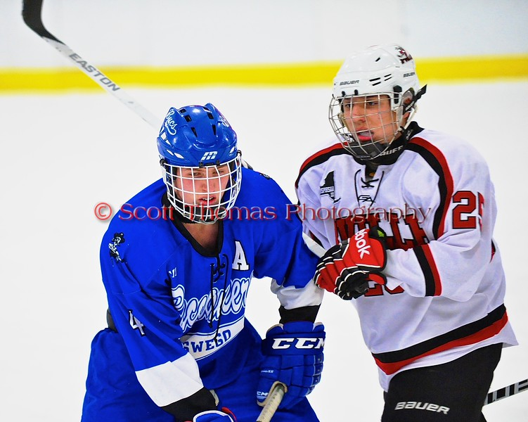Baldwinsville Bees Andrew Starrantino (25) and Oswego Buccaneers Noah Lee (4) at the Greater Baldwinsville Ice Arena in Baldwinsville, New York on Tuesday January 27, 2015.  Baldwinsville won 4-0.