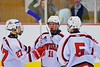 Baldwinsville Bees players Joe Glamos (18), Matt Metcalf (27) and Isaiah Pompo (5) celebrate a goal against the Oswego Buccaneers at the Greater Baldwinsville Ice Arena in Baldwinsville, New York on Tuesday January 27, 2015.  Baldwinsville won 4-0.