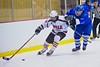 Baldwinsville Bees Joe Glamos (18) skates past Oswego Buccaneers Michael Chesare (10) at the Greater Baldwinsville Ice Arena in Baldwinsville, New York on Tuesday January 27, 2015.  Baldwinsville won 4-0.