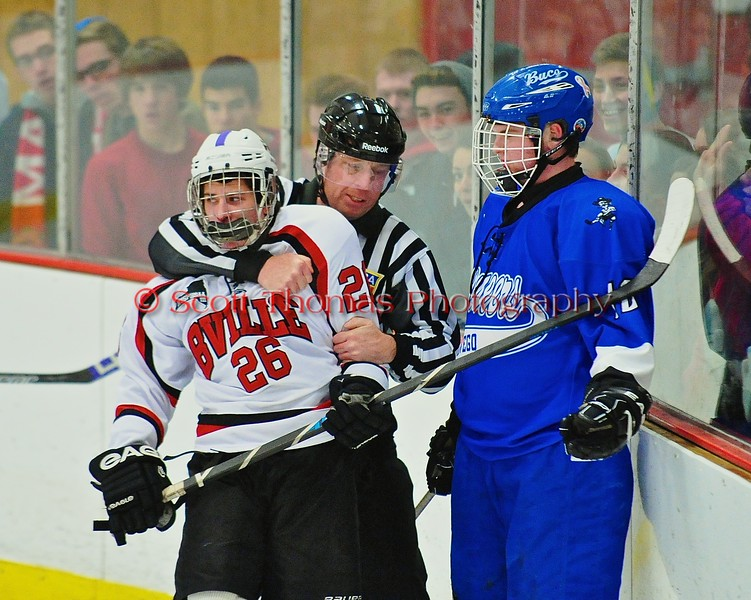Baldwinsville Bees Kyle Lindsay (26) being held back by the referee against the Oswego Buccaneers at the Greater Baldwinsville Ice Arena in Baldwinsville, New York on Tuesday January 27, 2015.  Baldwinsville won 4-0.