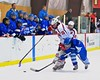 Baldwinsville Bees Charlie Bertrand (15) gets checked by Oswego Buccaneers Nate Schultzkie (26) at the Greater Baldwinsville Ice Arena in Baldwinsville, New York on Tuesday January 27, 2015.  Baldwinsville won 4-0.