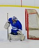 Oswego Buccaneers goalie Jarrett Dudley (30) makes a pad save against the Baldwinsville Bees at the Greater Baldwinsville Ice Arena in Baldwinsville, New York on Tuesday January 27, 2015.  Baldwinsville won 4-0.