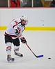 Baldwinsville BeesJoe Glamos (18) with the puck against the Oswego Buccaneers at the Greater Baldwinsville Ice Arena in Baldwinsville, New York on Tuesday January 27, 2015.  Baldwinsville won 4-0.