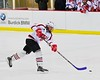 Baldwinsville Bees Charlie Bertrand (15) shoots and scores against the Oswego Buccaneers at the Greater Baldwinsville Ice Arena in Baldwinsville, New York on Tuesday January 27, 2015.  Baldwinsville won 4-0.
