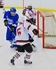 Baldwinsville Bees Isaiah Pompo (5) hits the crossbar against the Oswego Buccaneers at the Greater Baldwinsville Ice Arena in Baldwinsville, New York on Tuesday January 27, 2015.  Baldwinsville won 4-0.