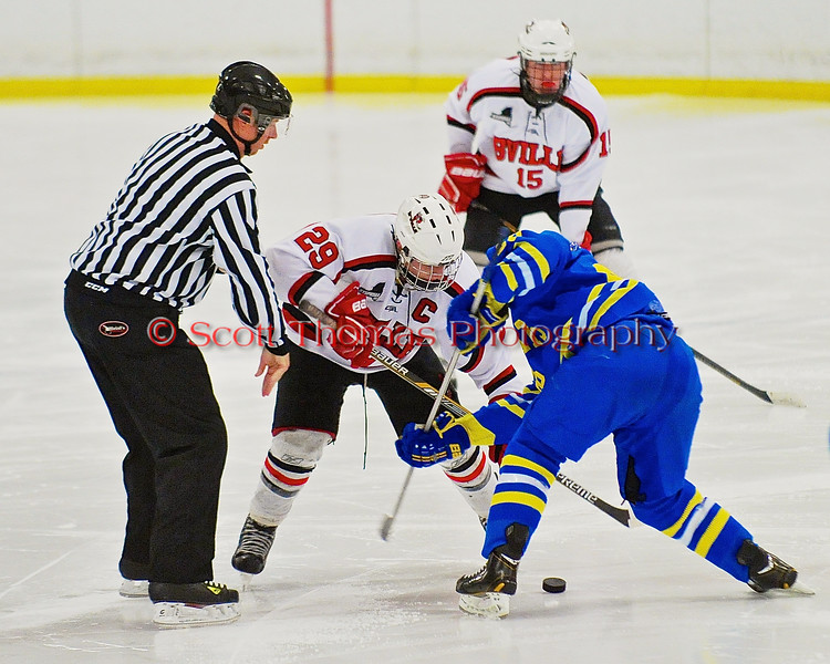 Baldwinsville Bees Matt Abbott (29) facing off with a West Genesee Wildcats player at the Greater Baldwinsville Ice Arena in a Section III Division I Boys Hockey Playoff game at Baldwinsville, New York on Tuesday February 24, 2015.  Baldwinsville won 5-0.