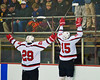 Baldwinsville Bees Charlie Bertrand (15) with Matt Abbott (29) celebrate Bertrand's goal against the West Genesee Wildcats at the Greater Baldwinsville Ice Arena in a Section III Division I Boys Hockey Playoff game at Baldwinsville, New York on Tuesday February 24, 2015.  Baldwinsville won 5-0.