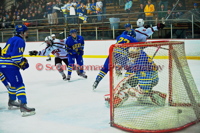Baldwinsville Bees Joe Glamos (18) scores a goal against West Genesee Wildcats at the Greater Baldwinsville Ice Arena in a Section III Division I Boys Hockey Playoff game at Baldwinsville, New York on Tuesday February 24, 2015.  Baldwinsville won 5-0.