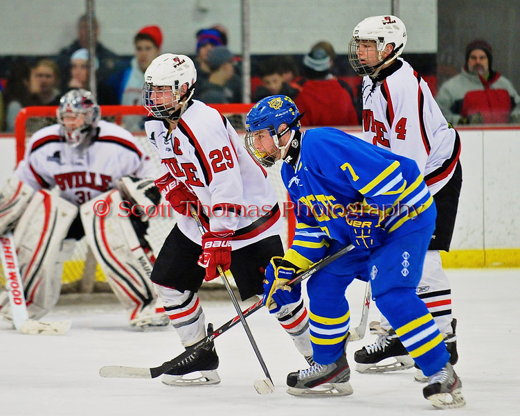Baldwinsville Bees Matt Abbott (29), Ben Dwyer (4) and West Genesee Wildcats Marshall Winn (7) before a face-off at the Greater Baldwinsville Ice Arena in a Section III Division I Boys Hockey Playoff game at Baldwinsville, New York on Tuesday February 24, 2015.  Baldwinsville won 5-0.