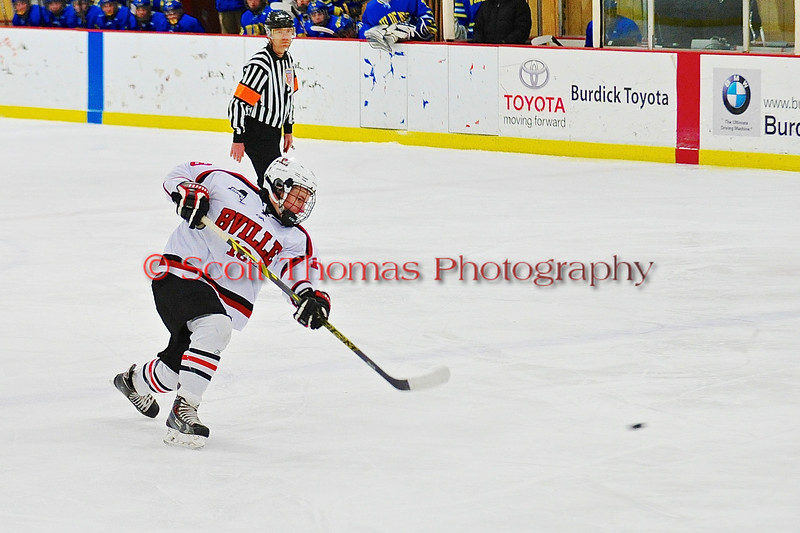 Baldwinsville Bees Joe Glamos (18) one times the puck at the West Genesee Wildcats net at the Greater Baldwinsville Ice Arena in a Section III Division I Boys Hockey Playoff game at Baldwinsville, New York on Tuesday February 24, 2015.  Baldwinsville won 5-0.