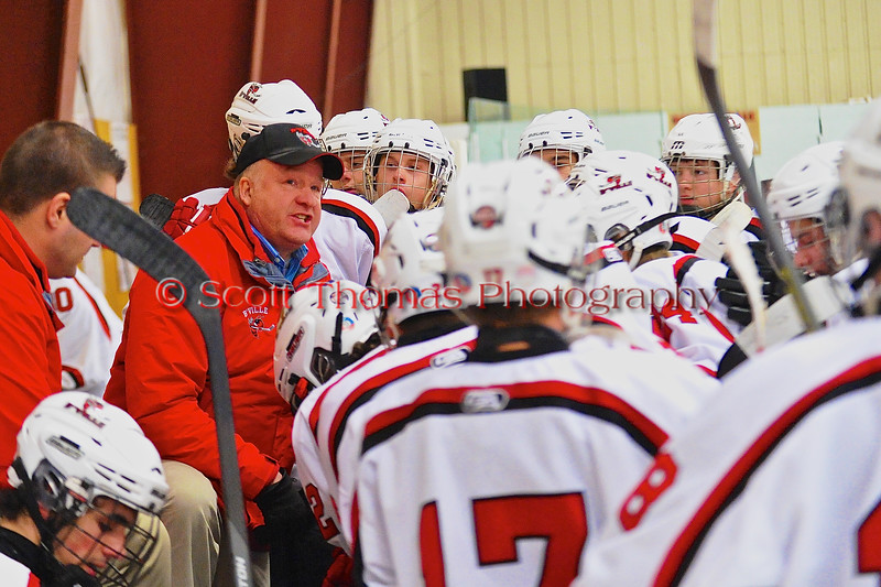 Baldwinsville Bees Head Coach Mark Lloyd talks to his players before the start of the third period against the West Genesee Wildcats at the Greater Baldwinsville Ice Arena in a Section III Division I Boys Hockey Playoff game at Baldwinsville, New York on Tuesday February 24, 2015.  Baldwinsville won 5-0.