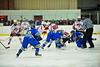 Baldwinsville Bees and West Genesee Wildcats players scramble after the opening face-off at the Greater Baldwinsville Ice Arena in a Section III Division I Boys Hockey Playoff game at Baldwinsville, New York on Tuesday February 24, 2015.  Baldwinsville won 5-0.