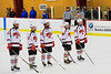 Baldwinsville Bees starting lineup Charlie Bertrand (15), Matt Metcalf (27), Matt Monaco (22), Kyle Lindsay (26) and Matt Abbott (29) announced before playing the West Genesee Wildcats at the Greater Baldwinsville Ice Arena in a Section III Division I Boys Hockey Playoff game at Baldwinsville, New York on Tuesday February 24, 2015.  Baldwinsville won 5-0.