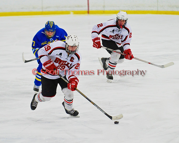 Baldwinsville Bees Matt Abbott (29) brings the puck up ice against the West Genesee Wildcats at the Greater Baldwinsville Ice Arena in a Section III Division I Boys Hockey Playoff game at Baldwinsville, New York on Tuesday February 24, 2015.  Baldwinsville won 5-0.