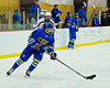 West Genesee Wildcats Conor Bartlett (2) with the puck against the Baldwinsville Bees at the Greater Baldwinsville Ice Arena in a Section III Division I Boys Hockey Playoff game at Baldwinsville, New York on Tuesday February 24, 2015.  Baldwinsville won 5-0.